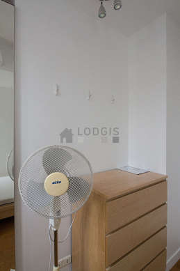 Very bright bedroom equipped with fan