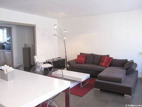 Living room furnished with tv, 1 armchair(s), 6 chair(s)