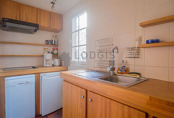 Kitchen where you can have dinner for 3 person(s) equipped with dishwasher, hob, refrigerator, freezer