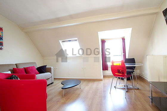Quiet living room furnished with 1 sofabed(s) of 140cm, tv, hi-fi stereo, wardrobe
