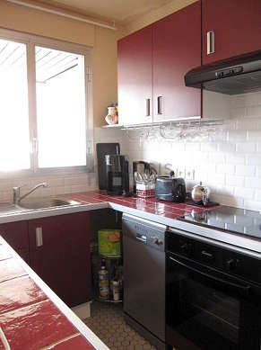 Kitchen equipped with dishwasher, hob, refrigerator, hood