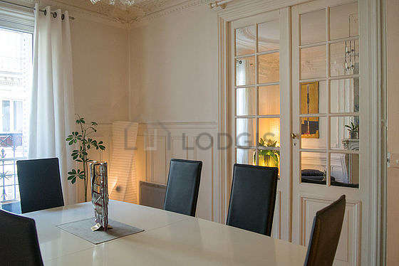 Dining room with double-glazed windows facing the road