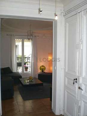 Beautiful entrance with wooden floor and equipped with 1 chair(s)