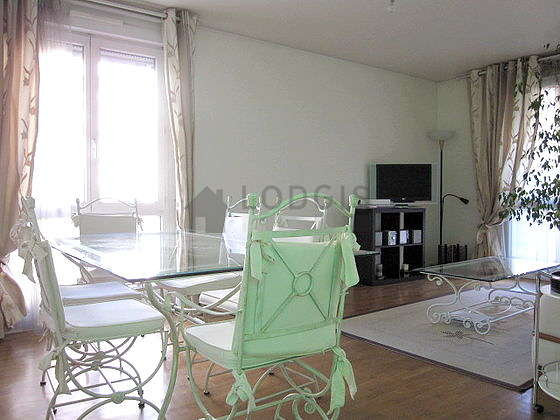 Quiet living room furnished with tv, hi-fi stereo, cupboard, 6 chair(s)