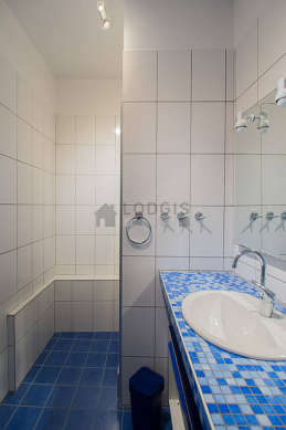 Bathroom equipped with separate shower, hair-dryer