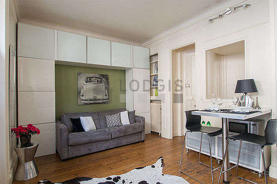 Bright living room furnished with cupboard