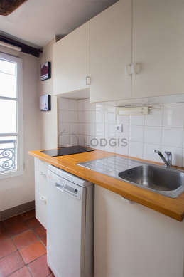 Kitchen with floor tiles floor