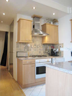 Kitchen where you can have dinner for 3 person(s) equipped with hob, refrigerator, freezer, extractor hood