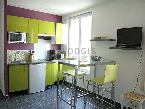Kitchen equipped with crockery, stool