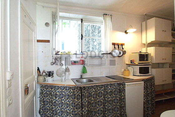 Kitchen where you can have dinner for 3 person(s) equipped with washing machine, refrigerator, crockery