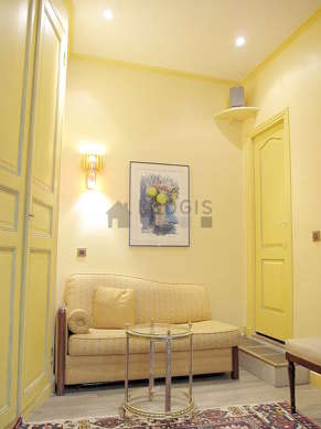 Very quiet living room furnished with hi-fi stereo, wardrobe, cupboard, 4 chair(s)