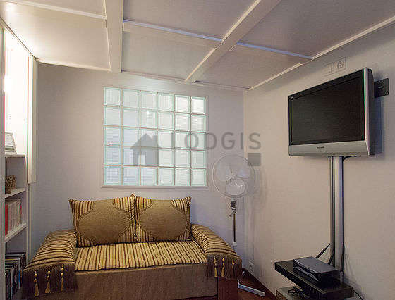 Bright bedroom equipped with tv, dvd player, 1 armchair(s)