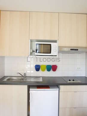 Kitchen equipped with hob, refrigerator, extractor hood