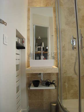 Bright bathroom with windows and with concrete floor