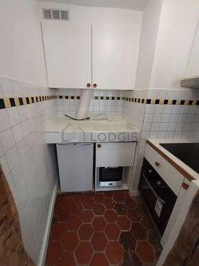 Kitchen with floor tiles floor