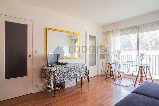 Bright living room furnished with cupboard, 3 chair(s)