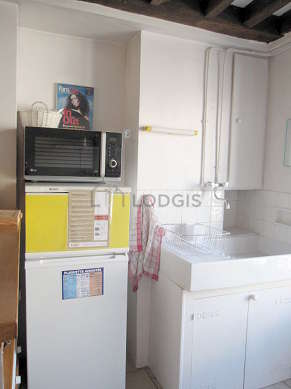Kitchen where you can have dinner for 2 person(s) equipped with hob, refrigerator, crockery, stool