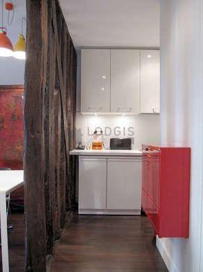 Magnifique cuisine de 6m²ouverte sur le séjour avec du parquet au sol
