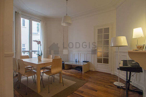 Dining room equipped with dining table, cupboard