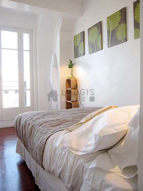 Bedroom with wooden floor