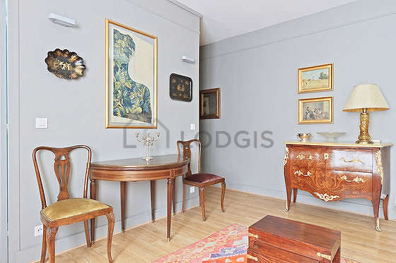 Very bright living room furnished with cupboard, 3 chair(s)
