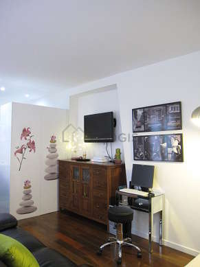 Very quiet living room furnished with tv, storage space, 5 chair(s)