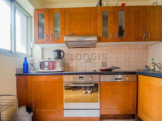 Kitchen equipped with washing machine, refrigerator