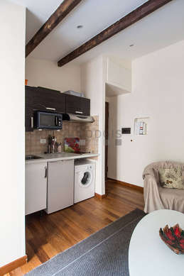 Kitchenopens on the living room with wooden floor