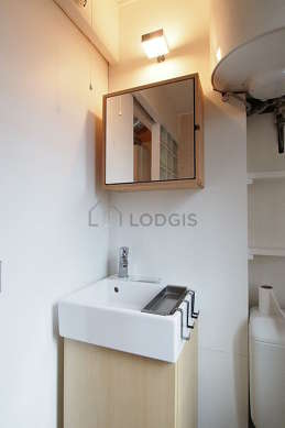 Beautiful and very bright bathroom with windows and with wooden floor