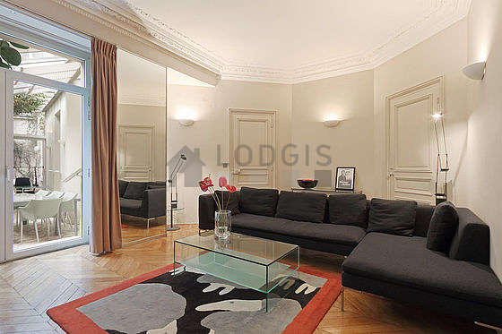 Very quiet living room furnished with tv, dvd player, wardrobe, cupboard