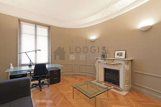 Very beautiful office with wooden floor furnished with sofa, 1 armchair(s)
