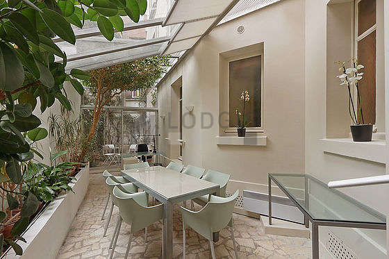 Very quiet and bright veranda equipped with dining table, 8 chair(s)