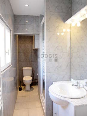 Bright bathroom with double-glazed windows and with wooden floor