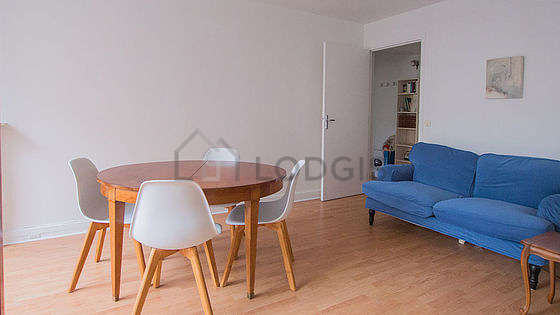 Quiet living room furnished with 1 bed(s), dining table, closet, 4 chair(s)