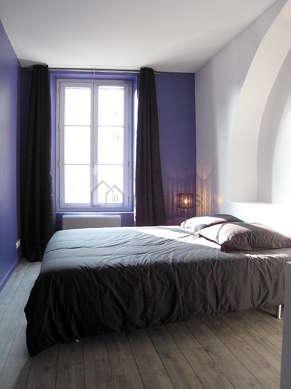 Bedroom with linoleum floor