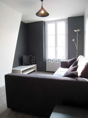 Living room furnished with 1 sofabed(s) of 160cm, tv