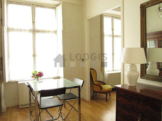 Dining room equipped with dining table, storage space, sideboard