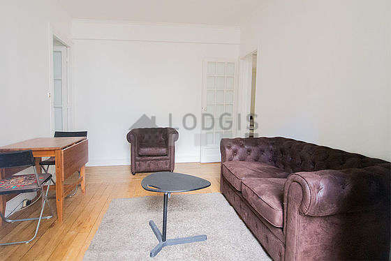 Quiet living room furnished with tv, 1 armchair(s)