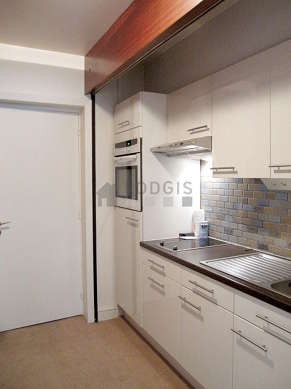 Kitchen with the carpeting floor