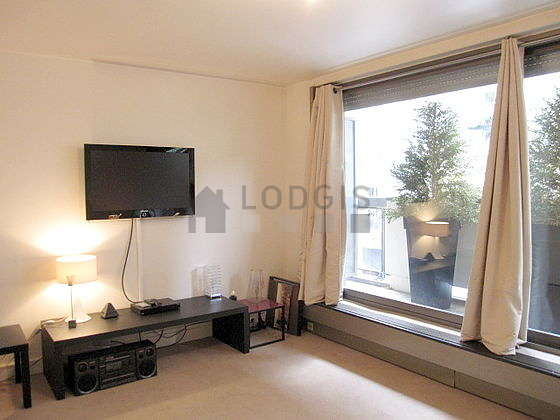 Very quiet living room furnished with 1 sofabed(s), tv, hi-fi stereo, closet