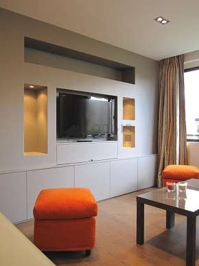 Living room furnished with 1 sofabed(s) of 160cm, tv, wardrobe, cupboard