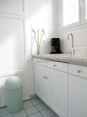 Kitchen equipped with washing machine, dryer, refrigerator, extractor hood