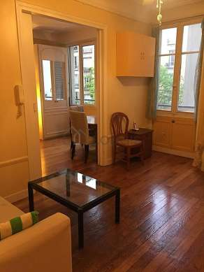 Very quiet living room furnished with sofa, coffee table, storage space, 2 chair(s)