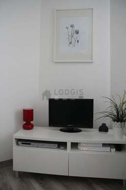 Very bright living room furnished with cupboard, 2 chair(s)