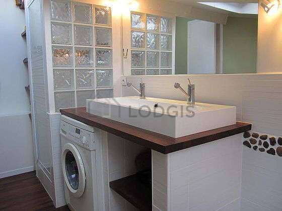 Pleasant and bright bathroom with windows and with wooden floor