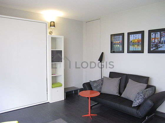 Bright living room furnished with cupboard, 2 chair(s)