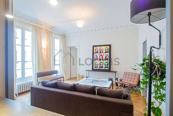 Quiet living room furnished with sofa, coffee table