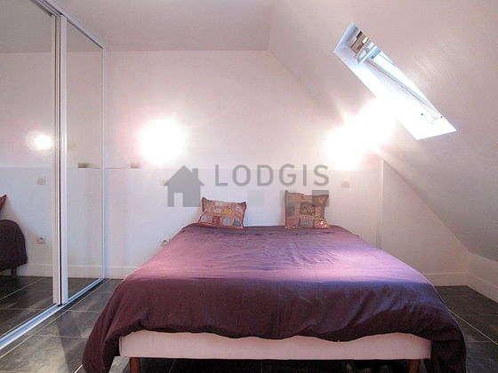 Bedroom with tile floor