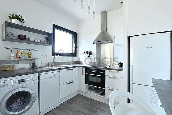 Kitchen equipped with washing machine, dryer, refrigerator, hood
