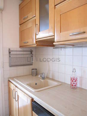 Kitchen equipped with washing machine, dryer, extractor hood, crockery